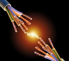 image of two electrical wires with a spark of electricity arcing between them