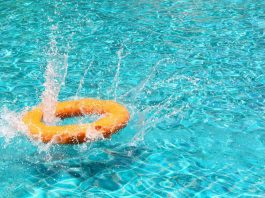a orange life ring floating in a swimming pool
