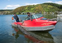 photo of a red boat on a lake