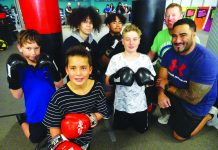 Photograph of the BOP Youth Development Trust boxing team and coach