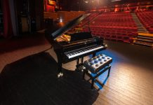 picture of a grand piano in a theatre