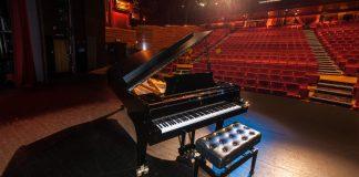 picture of a grand piano in a theatre
