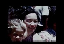 a close up shot of a woman in a crowd circa 1950's or 1960's