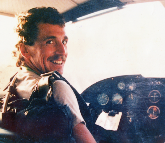 John Martin sitting at the controls of a Cesna plane